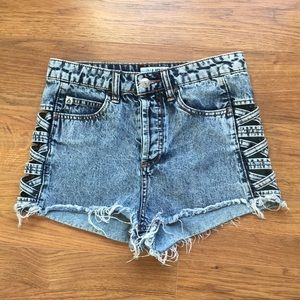 Jean shorts with open side , criss cross